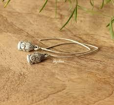 dangler earring buddha charm silver dangler earrings modern silver earrings