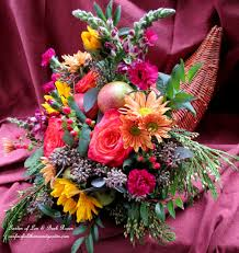 happy thanksgiving make a cornucopia of fresh fruit flowers