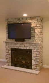 tv in the wall appealing corner stone stacked fireplace mantel f