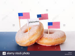 Welcome Flag Four Donuts With American Flags And A Welcome Flag Stock Photo