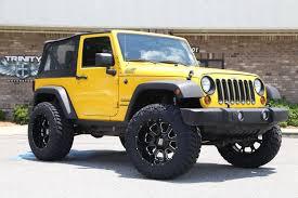 jeep lowered lifted 2011 jeep jk on kmc buck wheels trinity motorsports