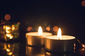 how long do tea lights burn tea light candles burning with bokeh lights on black background