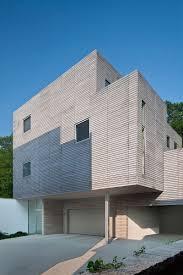 garage modern garage door design with concrete driveway at the