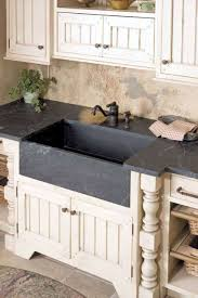 soapstone countertops sink installed with soapstone countertops and bronze faucet