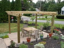 surprising wood table near cane work chair on floor for backyard garden ideas