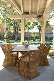 Salvaged Wood And Zinc Dining Table With Wicker Chairs - Wooden dining table with wicker chairs