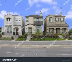 three houses photo three houses which stacked closely stock photo 685813
