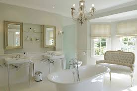 white french country bathroom with porcelain bathtub and subway