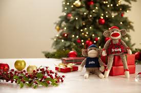 sock monkeys ornaments sitting on wrapped gifts on a table flickr
