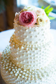 ivory wedding cake with pearl polka dots