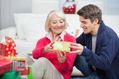 family giving gift to mother stock photos images u0026 pictures