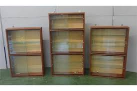 Wall Mounted Cabinet With Glass Doors by Pair Mahogany 2 Section Wall Hanging Cabinets With Sliding Glass