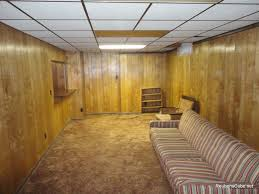 carpeted basement with wood panel walls and pool table homeyou