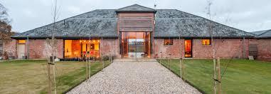 decrepit farm buildings reborn into modern energy efficient home