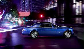 phantom car rolls royce phantom car coupe suite blue town night people road