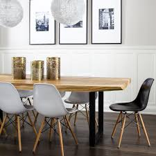 live edge dining table with eames molded plastic dining chairs