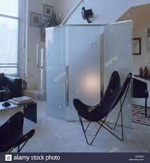 modern livingroom glass folding screen and black butterfly chair in modern