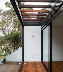 Wooden Pergola Designs by Wooden Pergola And Sliding Glass Panel Also Dark Steel Trusses