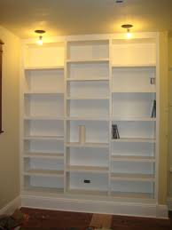built in bookcases made with furniture custom to ceiling
