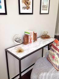console desk 10 minute ikea hack desk console ikea marble contact paper chair west elm pillow bookends vintage geometric terrarium