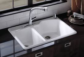 bathroom white kohler sinks plus stailess steel faucet near the