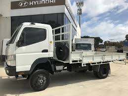 mitsubishi truck canter 2012 mitsubishi fuso canter 715 fg 4x4 table tray top drop sides