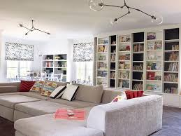 Family Room With Gray Pit Sectional And Built In Sliding Bookcases - Family room bookcases