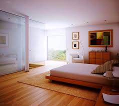 airy white bedroom and wooden floors laminate also brown area rug