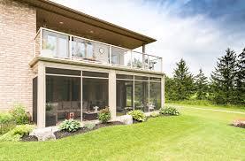 creating a backyard oasis tropical sunrooms