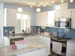 sky blue glass subway tile backsplash in modern white kitchen