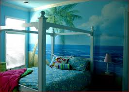 bedroom light blue wooden canopy bed with finials using beach