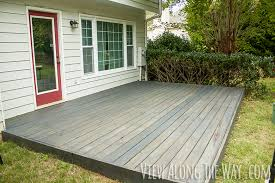 Wooden Decks And Patios Build And Stain A Short Deck Over The Ground To Cover An Old