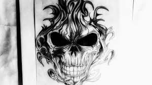 how to draw a flaming skull design