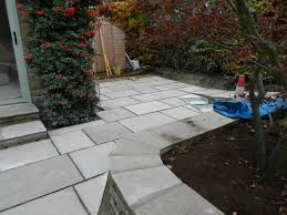 new drainage and large patio area olive garden design and