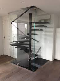 Spiral Staircase by Enclosed Floating Square Spiral Staircase Recent Projects