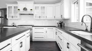 black kitchen countertops with white cabinets white farmhouse cabinets modern farmhouse highcraft cabinets