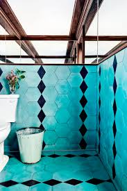 9 gorgeous restaurants we want to live in black tile bathrooms