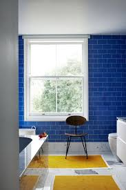 blue and yellow bathroom ideas blue tiles yellow bathmats bathroom design ideas houseandgarden