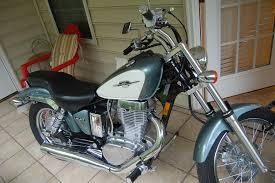 suzuki savage 650 pics specs and list of seriess by year