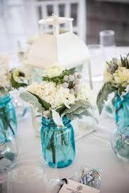 Beach Centerpieces For Wedding Reception by Beautiful Beach Themed Centerpiece Using Blue Mason Jars Starfish