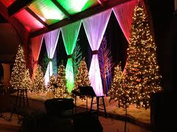 black colored christmas lights black fabric behind white fabric curtains with different colored