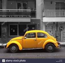volkswagen bug black yellow volkswagen beetle 1303 side view against black and white