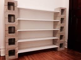 exterior cinder block and wooden bookcase combined with white