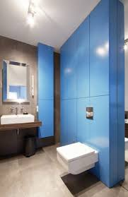 apartment chic and cool bathroom design with shiny blue wall