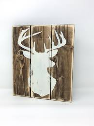 distressed wood sign with vintage white deer silhouette rustic