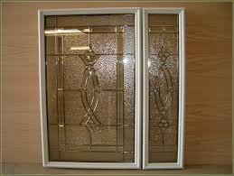 Decorative Glass For Kitchen Cabinets by Forged Metal Insert New White Kitchen Cabinet Doors With Metal