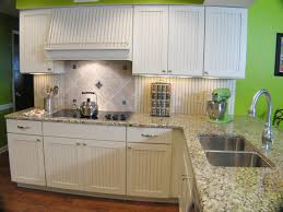 decor white kitchen cabinets and tile backsplash with quartz