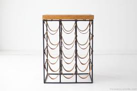 wine rack side table arthur umanoff wrought iron and leather wine rack 01191614
