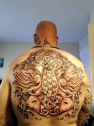 a norse back tattoo ft thor s hammer and his rams norse