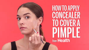 how to use concealer to cover up acne dark spots and more health